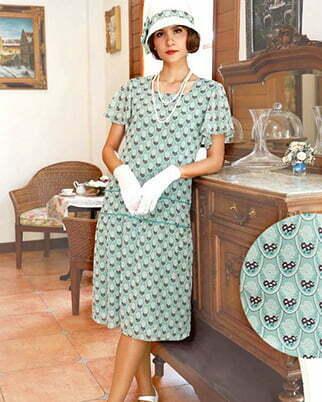 a woman wear a green tea dress