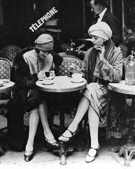 two 1920s women chatting