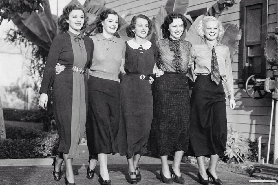 Five women with skirts