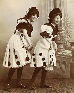 two women with polkdot dresses